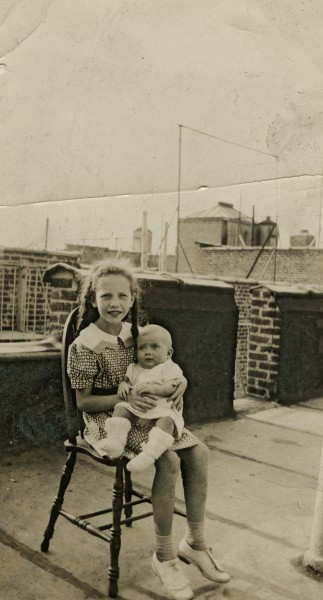 Young girl and baby on rooftop