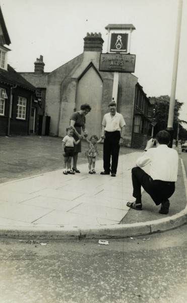 Albert McCourt taking a photograph of his parents and children outside his pub in Chelmsford, ENgland