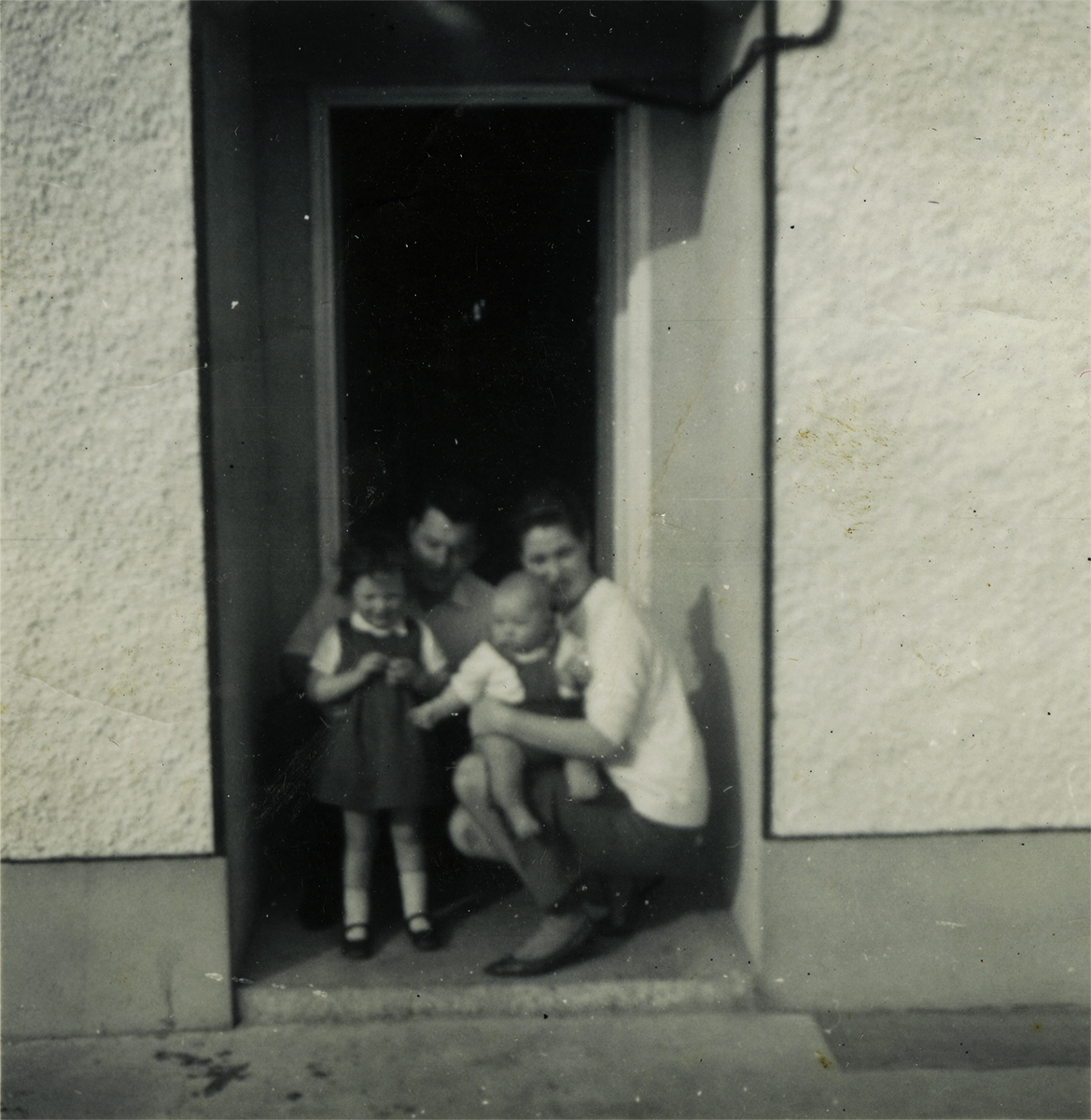Conlon // County Monaghan :: Seán & Kathleen McGreevey with their children Paula & baby Ken at their front door