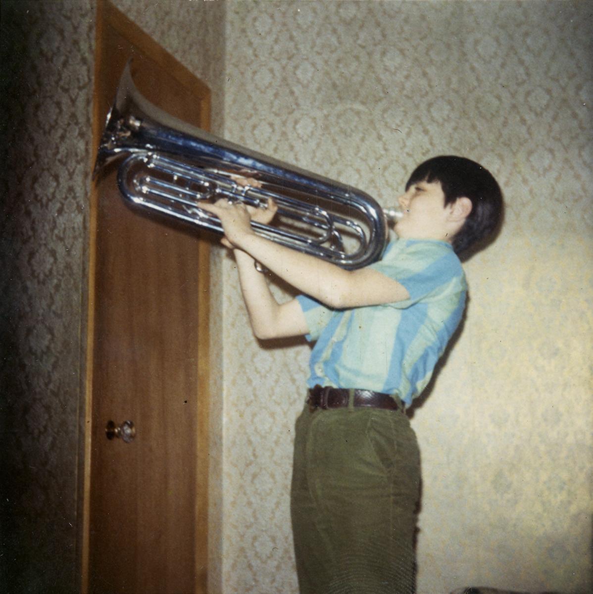 Conlon // Philadelphia & County Monaghan :: Seán playing a trumpet, Philadelphia, 1970s