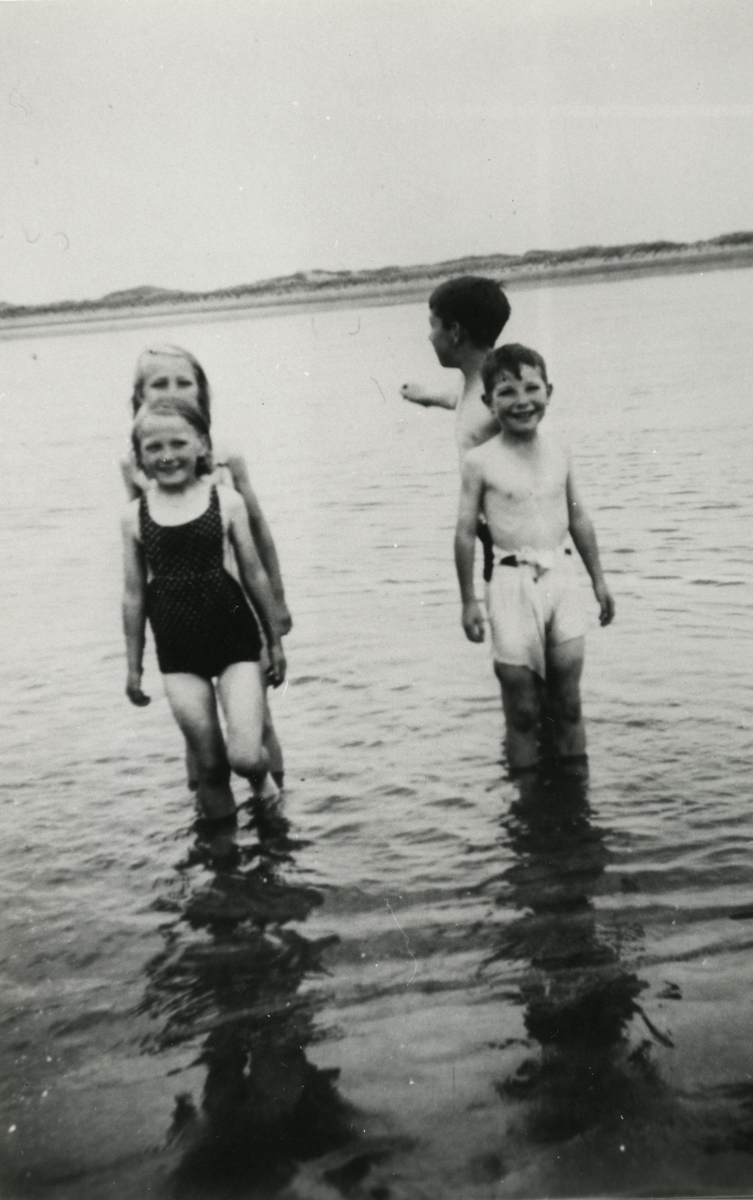 Campbell  //  County Dublin :: Children standing in the sea at Rush Beach, Dublin