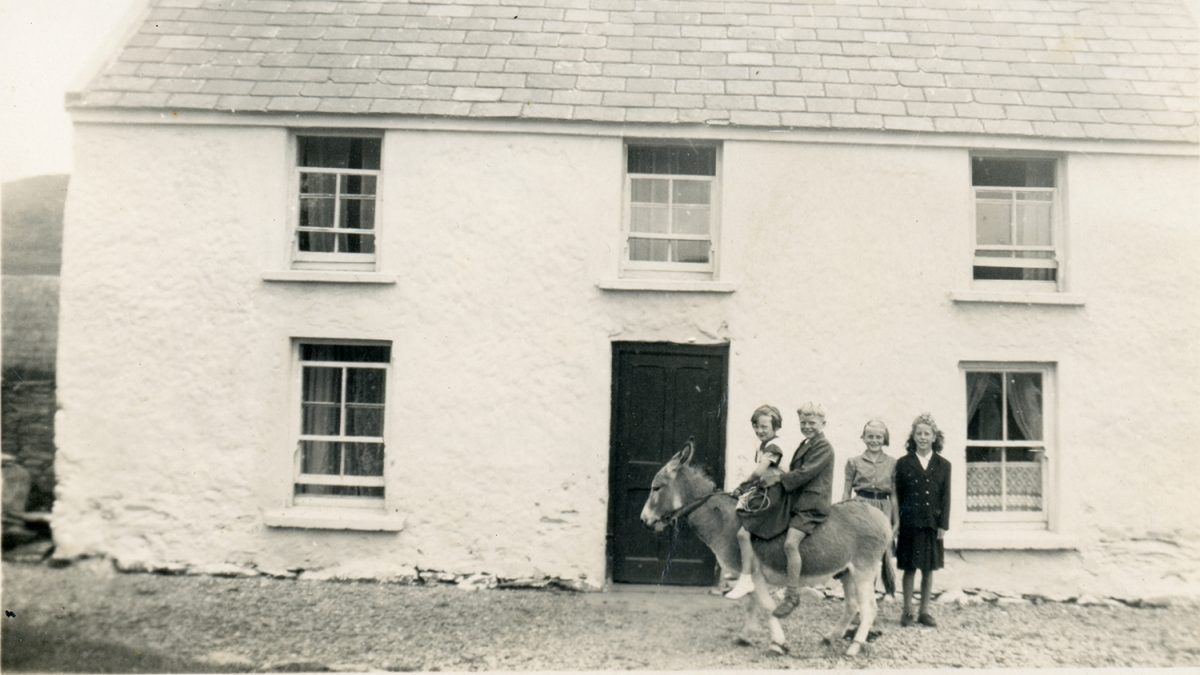 Dwyer Family // Boston and Beara :: Neighbours Anne Kelly and Mike Dwyer are on the Dwyers' donkey, while Marie Kelly and Mike's sister, Eileen stand to attention for the camera.
