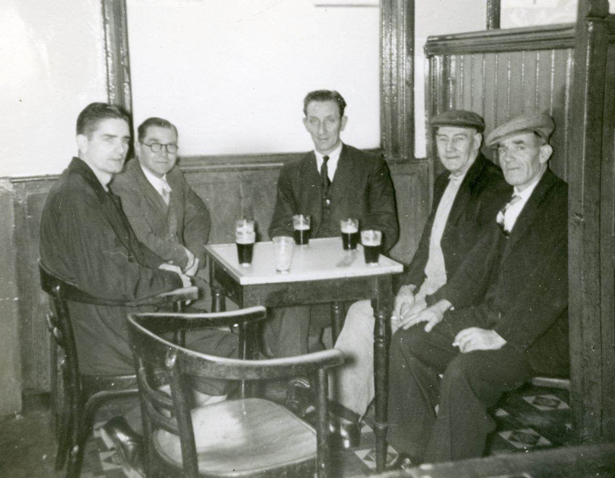 McNally // Boston & Lurgan :: James (Jimmy) McNally (left) with four men in pub, McConville's Bar, Portadown, N. Ireland, August, 1954