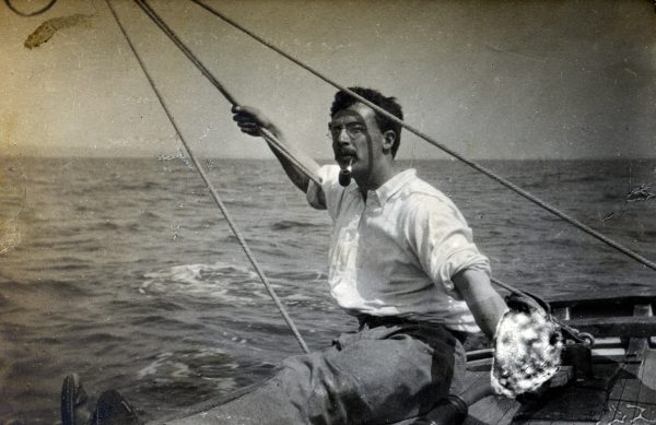 Erskine Childers smoking a pipe on board the yacht Vixen, 1898